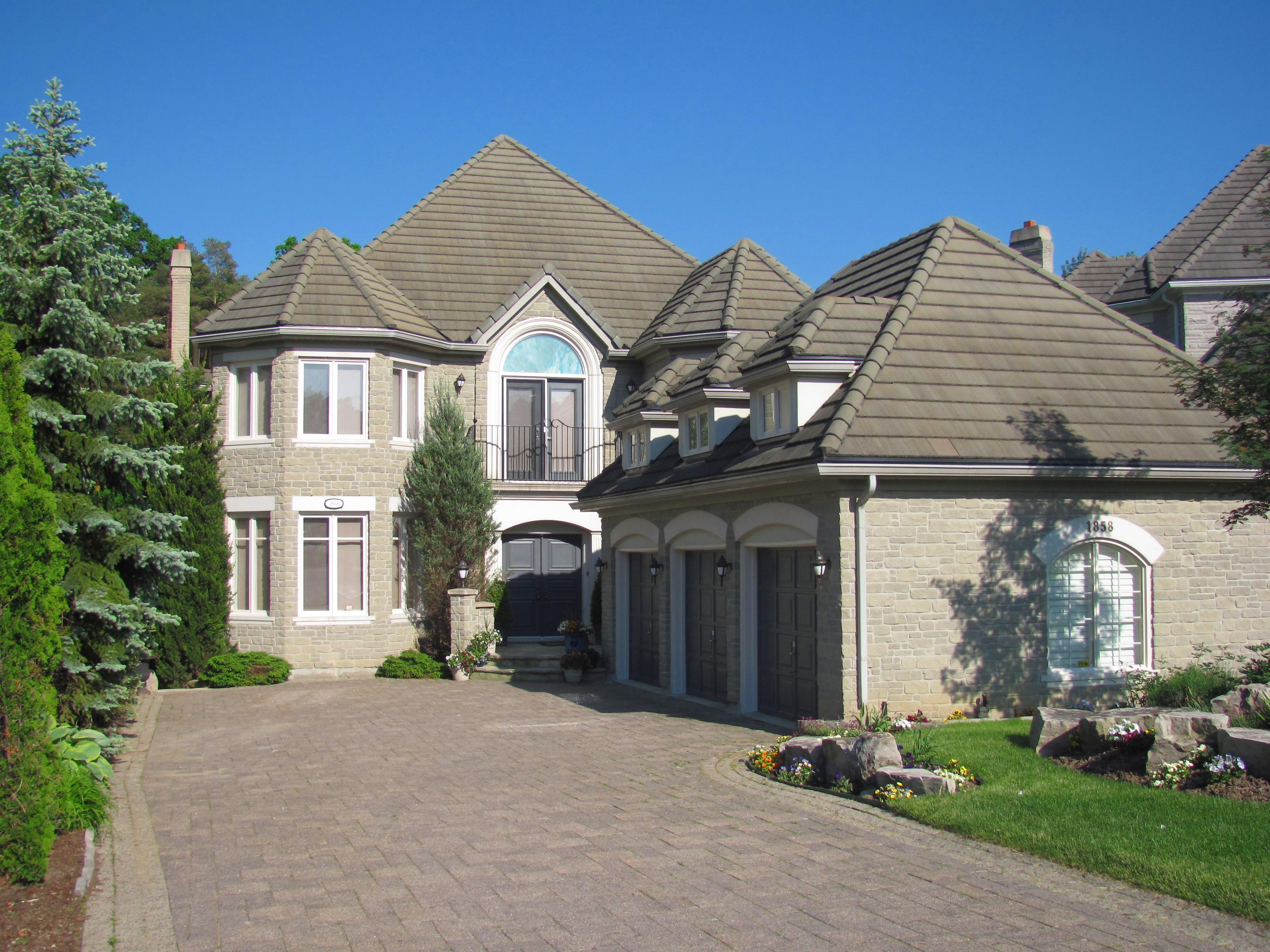 Chipkar Real Estate Mississauga Triple Garage Stone Driveway